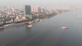 On the river float boats. In the background is the Guangzhou city, China stock footage