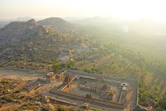 Sunrise in Hampi on Matanga hill. View from above, from the sky, aerophoto. Indian temple Hampi in the sun stock images
