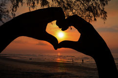 Sunrise in Hand Heart Frame on Beach View. Stock Image