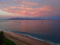 Pink Sunrise Reflecting in Ocean with Island in Background and C Royalty Free Stock Photography