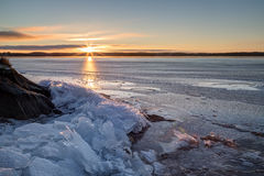Sunrise and heap of cracked ice at a frozen lake Royalty Free Stock Images