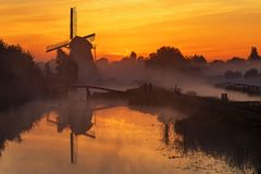 Sunrise heats up the canal water into the mist royalty free stock photos
