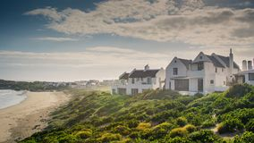 Holiday villas next to the beach at sunrise Royalty Free Stock Images
