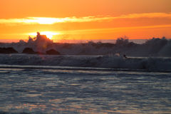 Sunrise and high surf Royalty Free Stock Photo