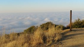 An Ocean of Fog. Sunrise Hike up to the Teepee Royalty Free Stock Image
