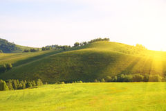 Sunrise from the hills. The bright morning sun and the field Stock Photo