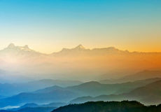 Sunrise in hills of himalaya. Scene of mountains during early sunrise in Himalaya stock image