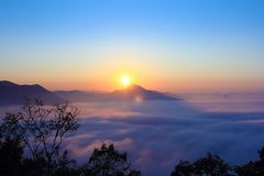 Sunrise on hilltop with adventure and camping in vacation at Tha. Iland Royalty Free Stock Photos