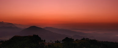 Sunrise in Himalaya. Colorful sunrise in Himalayan submountain Royalty Free Stock Image