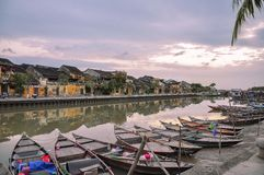 Sunrise at Hoi An, Vietnam. Beautiful sunrise at Hoi An, Vietnam early in the morning with blue sky and clouds and fisherman boats in front of an old houses stock photography