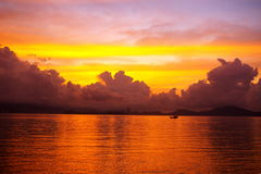 Sunrise in Hong Kong over the sea. Sunrise along seashore with a lonely ship in Hong Kong Royalty Free Stock Images
