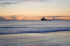 Sunrise horizon. Oil supply ship on the horizon at sunrise Royalty Free Stock Images