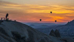 Sunrise with hot-air balloon and photographer stock images