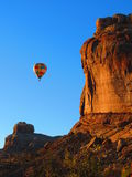 Sunrise Hot Air Balloon Ride. It's sunrise in Moab, Utah ant this hot air balloon is giving it's visitors a picturesque view of the mesa just outside of Arches Royalty Free Stock Photo