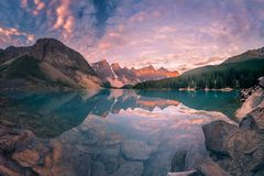 The Sunrise hour at Banff. This is a super wide angle panorama of Moraine lake at Banff National Park, Canada stock photo