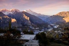 Sunrise at Hunza Nagar valley. Gilgit Baltistan, Pakistan. Sunrise at Hunza Nagar valley. Morning sunlight shining at snow capped Rakaposhi mountain in royalty free stock photography