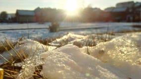 Sunrise. Ice at house Stock Photos