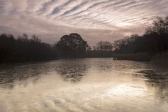 Sunrise over a frozen Ornamental Lake on Southampton Common stock image