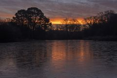 Sunrise on a icy morning at Southampton Common royalty free stock images