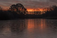 Sunrise on a icy morning at Southampton Common royalty free stock photography