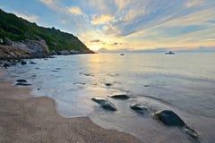Sunrise on idyllic tropical beach. Golden sunrise on the tropical beach of Ao Leuk, south east of Koh Tao island, Southern Thailand Stock Image