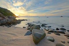Sunrise on idyllic tropical beach Stock Photo