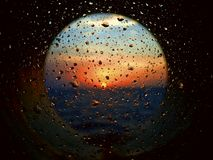 Sunrise through illuminator with drops of water and salt Royalty Free Stock Image