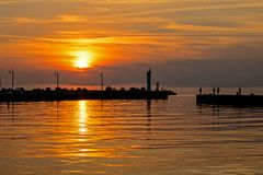 Fishing From The Pier At Sunrise In Bronte, Ontario, Canada. Sunrise image taken on the shores of Lake Ontario at Bronte Beach in Oakville, Ontario, Canada stock images