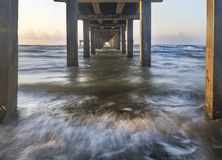 Under the Port Aransas Pier Mustang Island Texas. Sunrise image of the view under the ocean pier along the Gulf of Mexico in Port Aransas Texas Stock Image