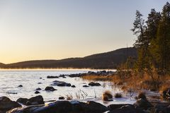 Sunrise at Inari lake, Finland Stock Photography