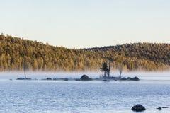 Sunrise at Inari lake, Finland Royalty Free Stock Photos