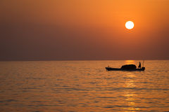 Sunrise on the indian ocean. With fising boats Royalty Free Stock Photo