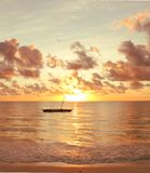 Sunrise on the Indian Ocean. Sun rising behind a traditional dhow on the Indian Ocean, Zanzibar Stock Photography
