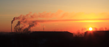 Sunrise in the industrial city. Royalty Free Stock Photos