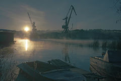 Sunrise. On industrial cranes RANS boats stock image
