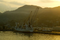 Sunrise Industrial Port. Industrial port off the coast of Manzanillo, Mexico - All boat logos and names removed Stock Image