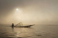 Sunrise on Inle Lake with a boat of fisherman Stock Photography