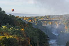 Sunrise From Inspiration Point At Letchworth State Park. In New York With A Hot Air Balloon Flying Near The Railroad Trestle royalty free stock photos