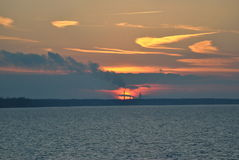 Sunrise. The instant at which the upper edge of the Sun appears over the eastern horizon in the morning stock photo
