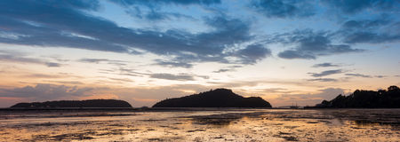Before Sunrise on the island, tide down the beach as far as the Royalty Free Stock Images
