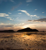 Sunrise on the island, tide down the beach as far as the eye can Royalty Free Stock Images