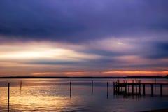 Sunrise on the James. Sunrise over a dock on James River outside Jamestown Stock Photos