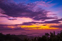 Sunrise in Jawa Tengah, Indonesia. View of Gunung Merbabu. Mysticism and fog during sunrise over Candi Borobudur. Incredible colorful clouds of pink, the sky is royalty free stock photo