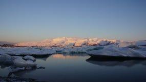 Sunrise at Jokulsarlon glacier lake. Sunrise early in the morning at Jokulsarlon glacier lake in Iceland royalty free stock images