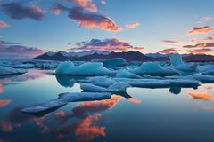 Sunrise in Jokulsarlon. iceland ice lagoon of jokulsarlon in the morning in summer or winter. Blue icebergs stock image
