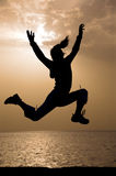 Sunrise jumping. 6:02 am. Stock Photos