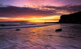Sunrise from King Edward`s Bay in Tynemouth, England royalty free stock images