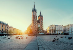 Sunrise in Krakow. Poland. Market square in Krakow at sunrise. Mariacki Cathedral. Poland stock photography