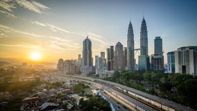 Sunrise at Kuala Lumpur city centre from rooftop of a building. City skyline and sunrise Royalty Free Stock Photos