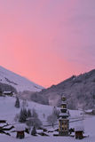 A sunrise at La CLusaz, in the French Alps, with the Church in the middle of the village Royalty Free Stock Photography